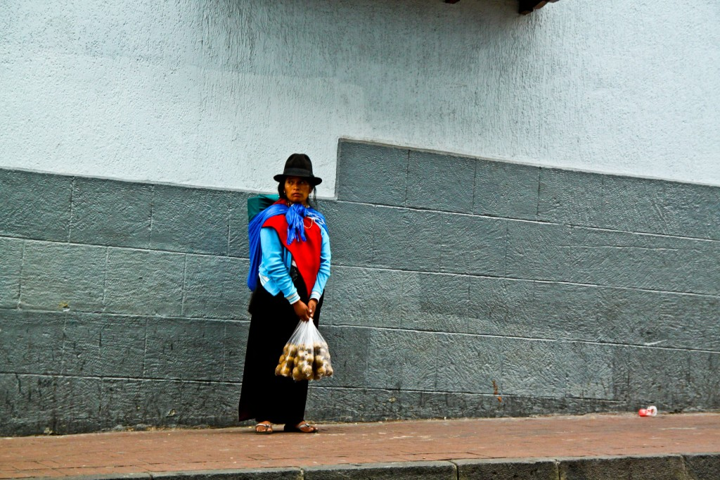Una chola sells papitas around the historic center of Quito.