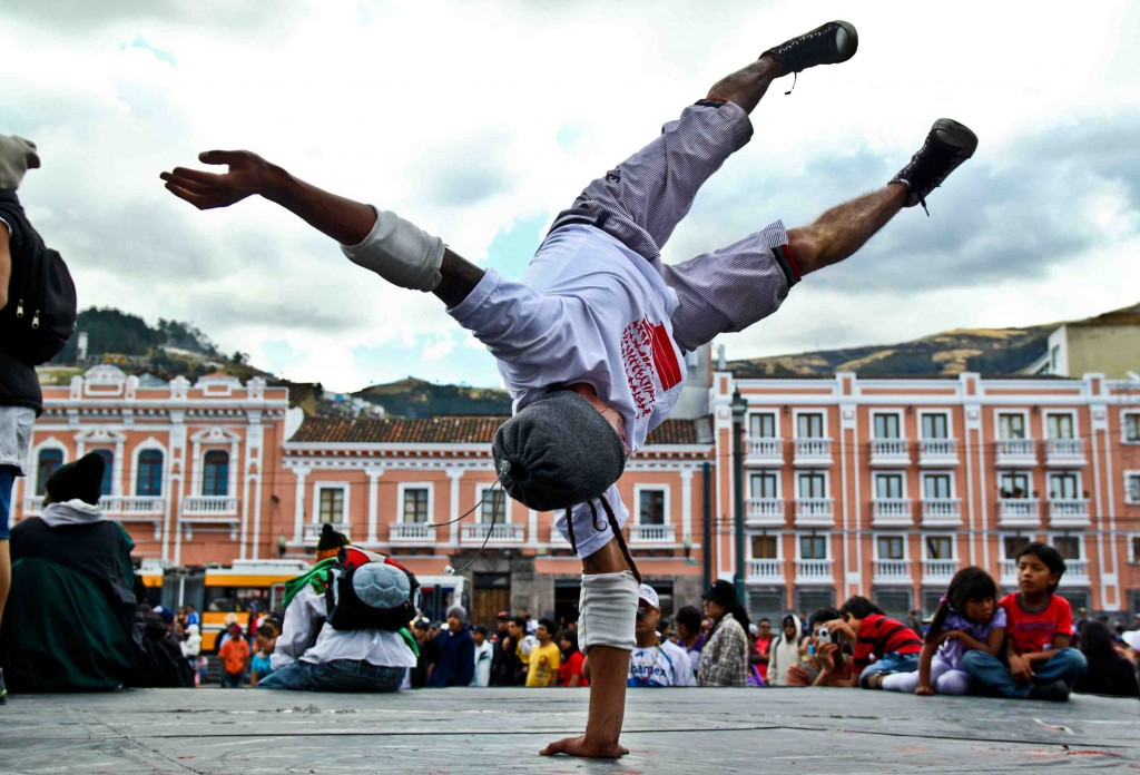 El Gran Miguel de El Iwias Crew Breakdancers of Quito, Ecuador throws down during the Alfaro Vive Hip Hop Festival in el Centro, Historico...  Camera: Canon Rebel T1i Lens: Sigma 17-50mm, f/20 Focal Length: 21 mm Exposure settings: 1/800 sec at f/4.5, ISO 200